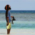 Jamaican man overlooking the sea